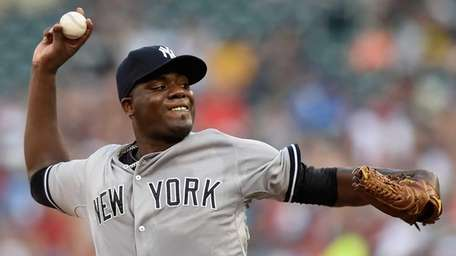 Michael Pineda #35 of the Yankees delivers a
