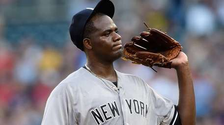 Michael Pineda of the Yankees reacts to giving