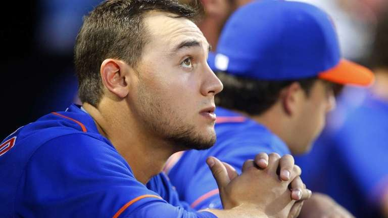 Michael Conforto of the Mets looks on from