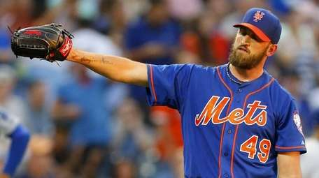 Jonathon Niese of the Mets looks on after