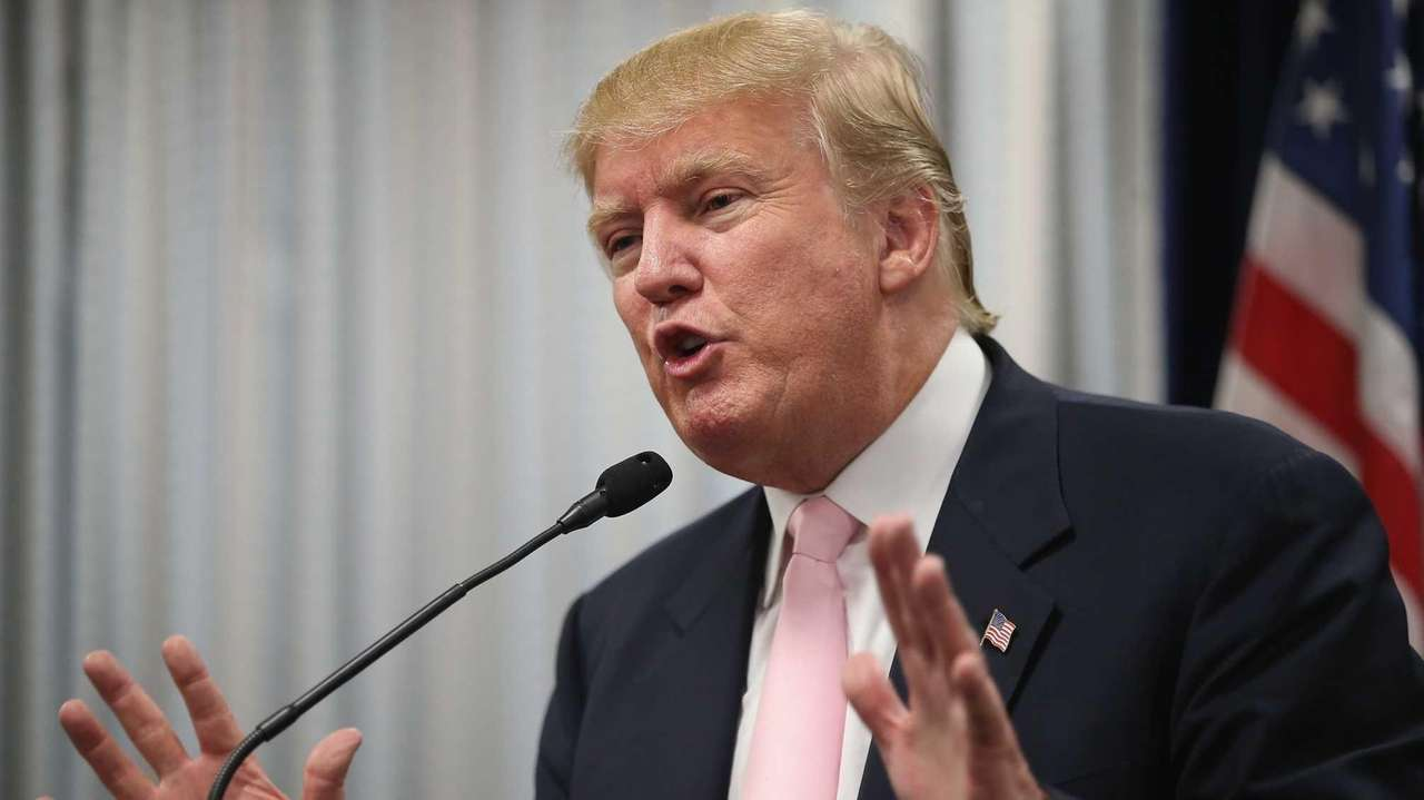 Republican presidential candidate Donald Trump speaks to the