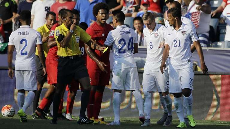 Panama and United States players argue after a
