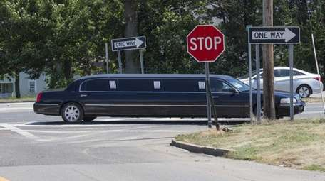 A limousine heading eastbound on Route 48 and