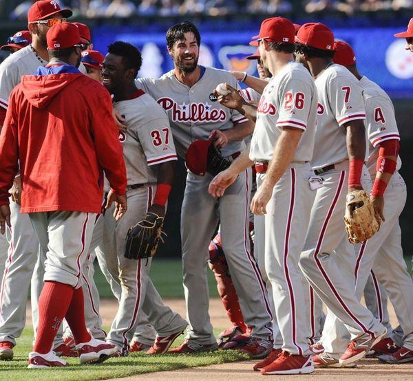 Philadelphia Phillies starting pitcher Cole Hamels, center, is