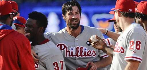 Philadelphia Phillies starting pitcher Cole Hamels, center, is