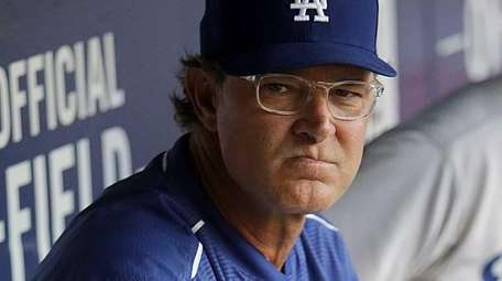 Los Angeles Dodgers manager Don Mattingly looks on