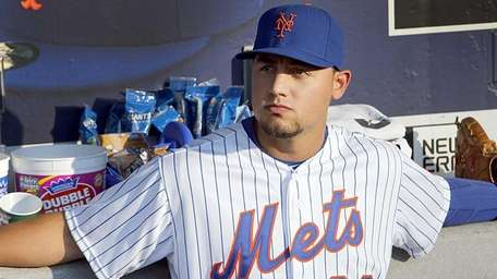 New York Mets leftfielder Michael Conforto sits in