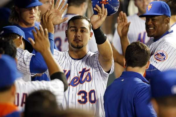 New York Mets leftfielder Michael Conforto high-fives teammates