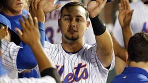 New York Mets leftfielder Michael Conforto high-fives teammates