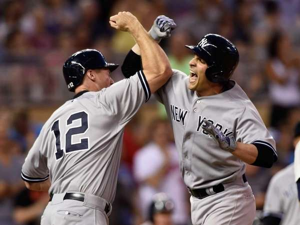Chase Headley of the New York Yankees congratulates