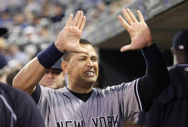 New York Yankees designated hitter Alex Rodriguez congratulates