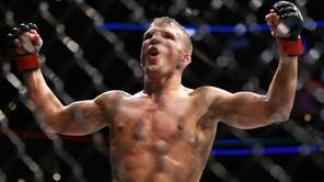 TJ Dillashaw celebrates after defeating Renan Barao during