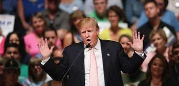 Republican presidential hopeful businessman Donald Trump speaks to