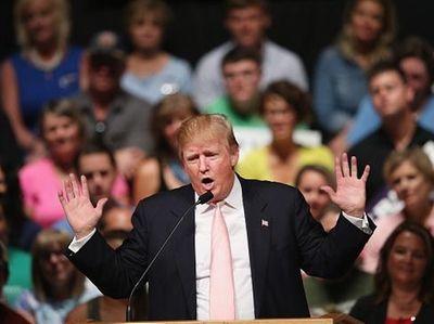 Republican presidential hopeful businessman Donald Trump speaks to