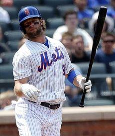 Mets leftfielder Kirk Nieuwenhuis is hit by a