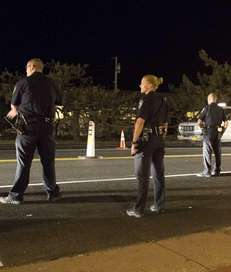 East Hampton Town Police, on foot patrol, with