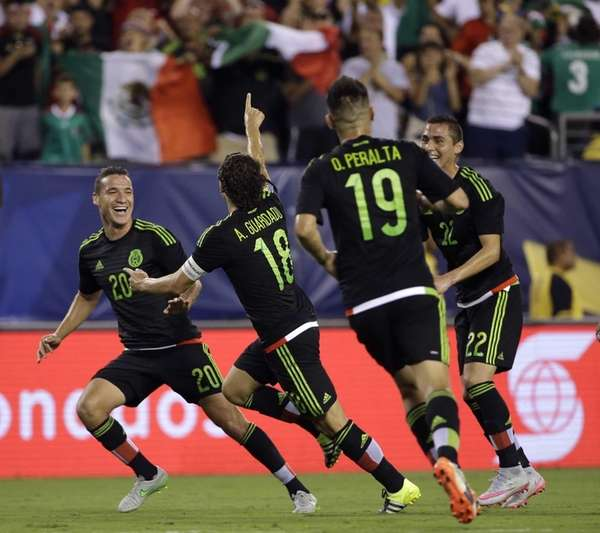 Mexico's Andres Guardado, (18) celebrates his goal with