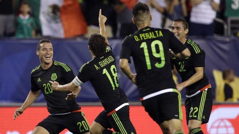 Mexico's Andres Guardado, (18) celebrates his goal with