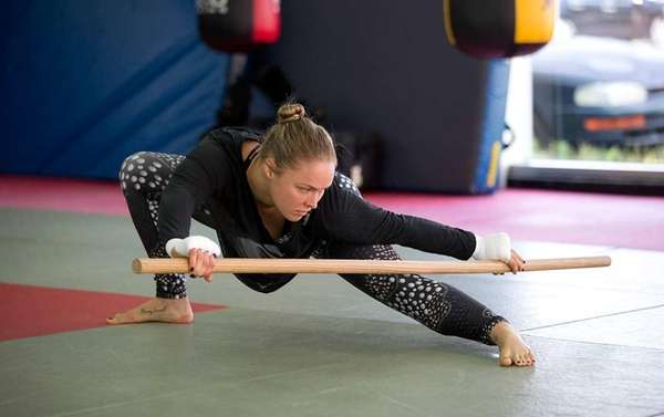 UFC women's bantamweight champion Ronda Rousey stretches during