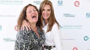 Actress Aida Turturro and actress Brooke Shields stop