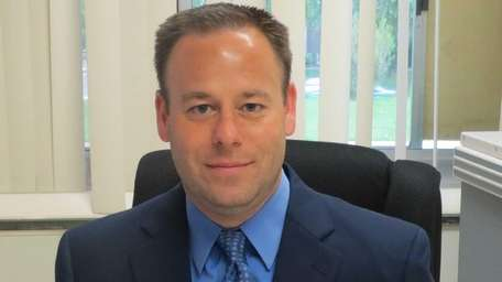 Jon Trapani of Farmingdale has been promoted to