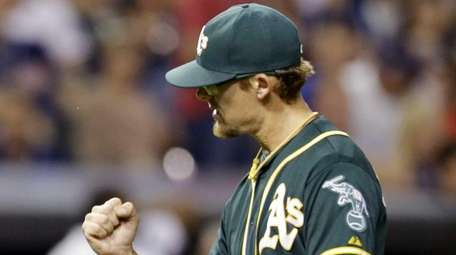 Oakland Athletics relief pitcher Tyler Clippard pumps his