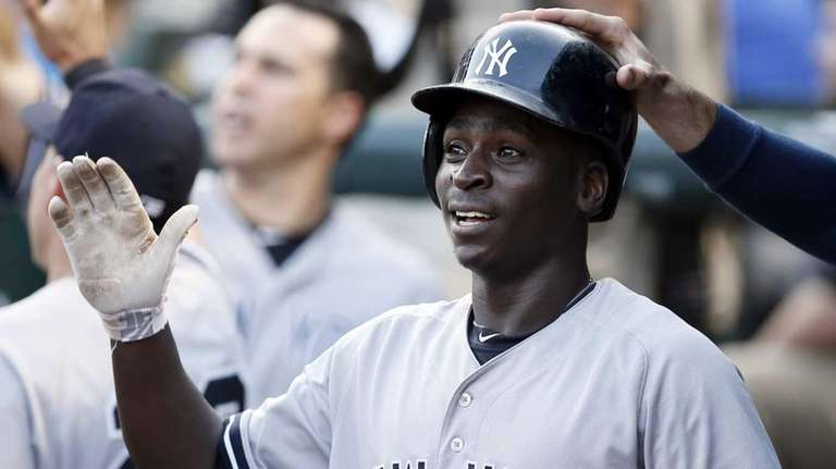 The New York Yankees' Didi Gregorius is congratulated