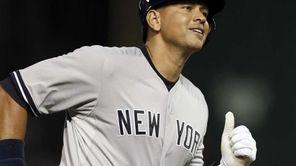 New York Yankees designated hitter Alex Rodriguez smiles