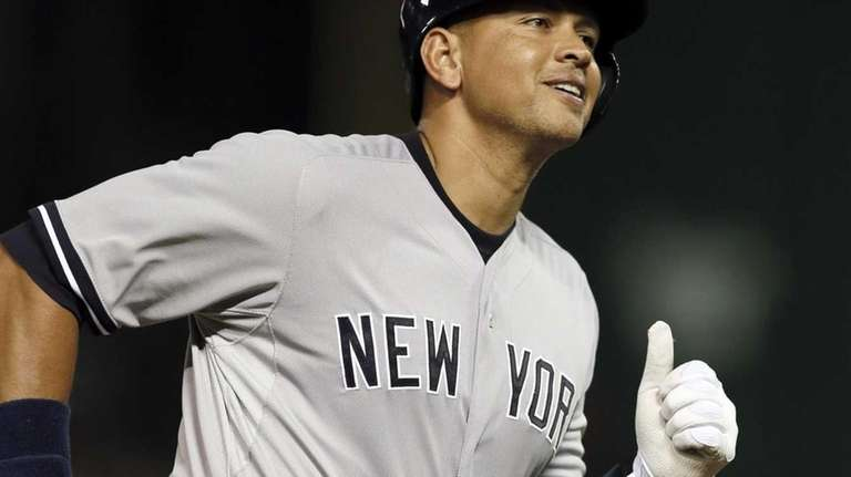 New York Yankees designated hitter Alex Rodriguez smiles