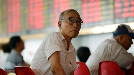 An investor in Shanghai, China, watches glumly as