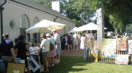 The clothesline art sale takes place in and