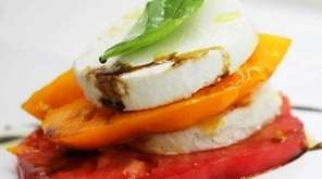 Jay Astafa's caprese salad features house-made cashew-milk mozzarella.