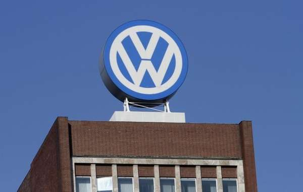 The Volkswagen logo is on the company's headquarters