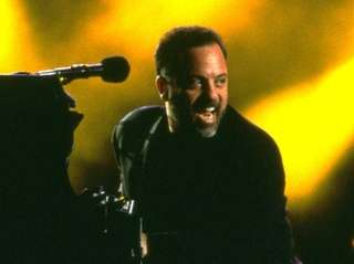 Billy Joel performs at Nassau Veterans Memorial Coliseum