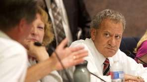 Legis. Tom Muratore listens to debate about a
