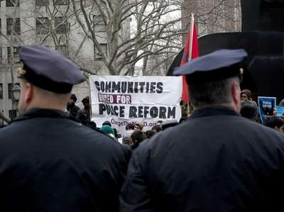 New York City Police officers watch over a