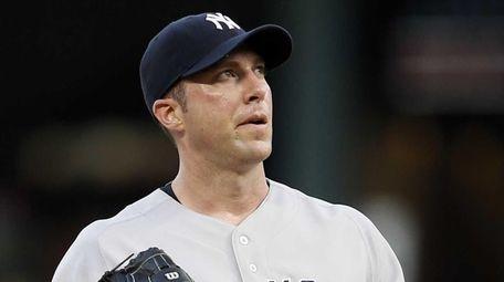 The New York Yankees' Chris Capuano looks skyward