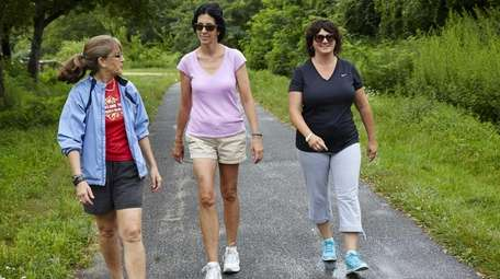 Maureen Quinn-Morse, Cheryl Clifford and Suzanne Peluso walk