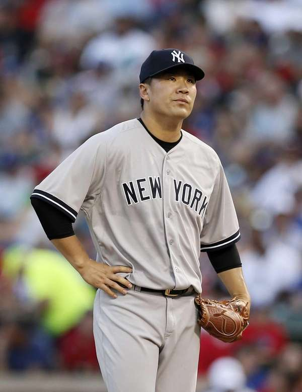 New York Yankees starting pitcher Masahiro Tanaka stands