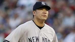 New York Yankees starting pitcher Masahiro Tanaka stands