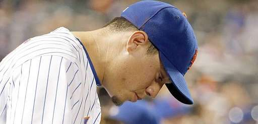 Mets shortstop Wilmer Flores in the dugout during