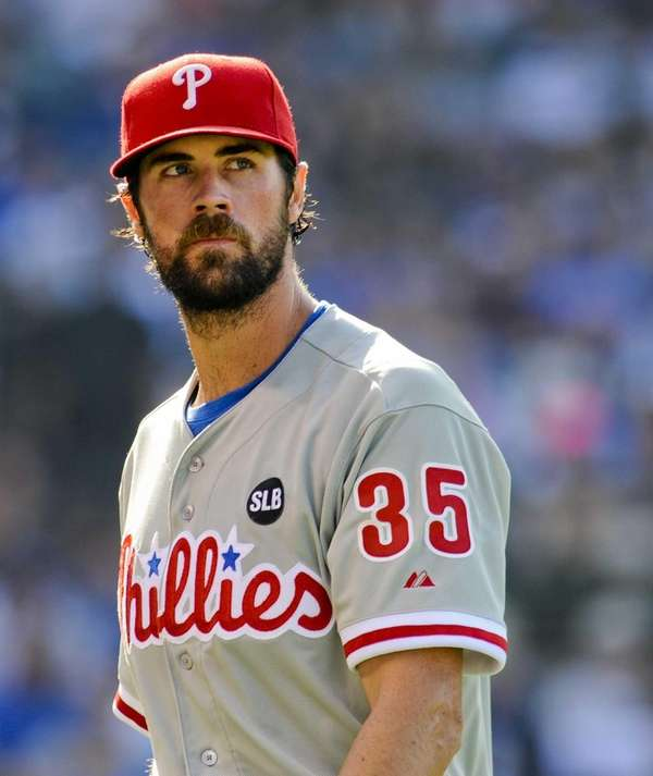 Philadelphia Phillies starting pitcher Cole Hamels looks on