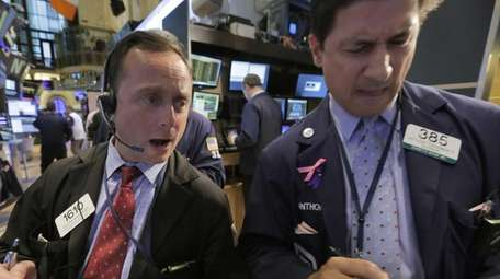 Traders George Baskinger, left, and Anthony Carannante work