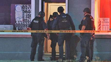 Police at the scene of a shooting at