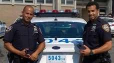 NYPD Officers Jose Suriel and Angel Ramos, both