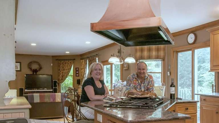 Peter and Mary Mondrick sitting in their kitchen