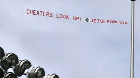 A banner towed by an airplane over the