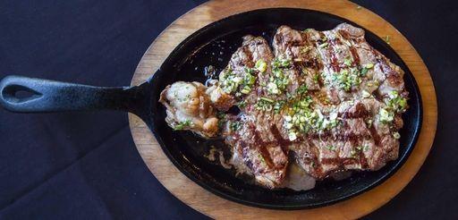 Churrasco, a sirloin steak, is served with chimichurri