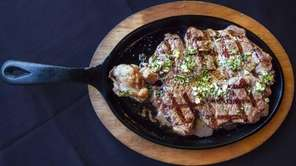 Churrasco, a sirloin steak, is served with chimichurri