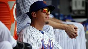 New York Mets shortstop Wilmer Flores follows the